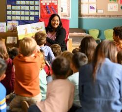 Teacher reading book to class