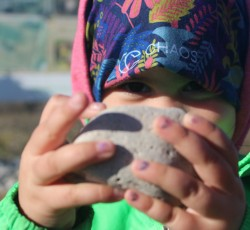 Child holding rock. Photo courtesy Tanya Leary