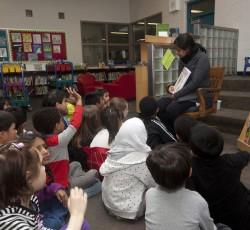Teacher reading to class. Photo by Kathryn Gaitens