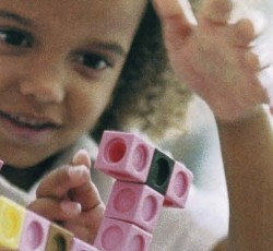 young girl playing with legos