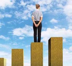 Image of woman standing on bar graph