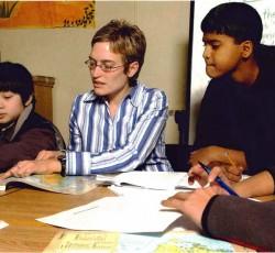Teacher in school teaching class