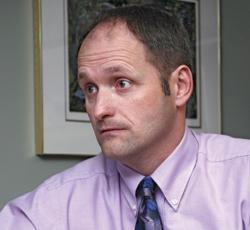 man staring intently at something out of frame
