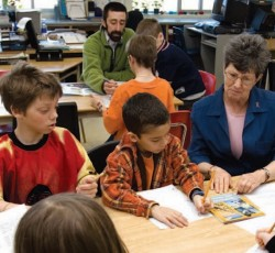 Teachers working with students in classroom