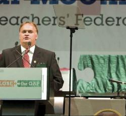 etfo member standing at podium speaking to crowd out of frame