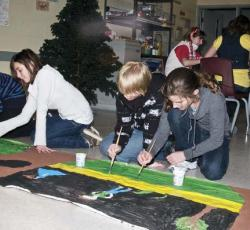 young students painting
