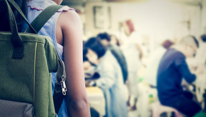 kid wearing backpack