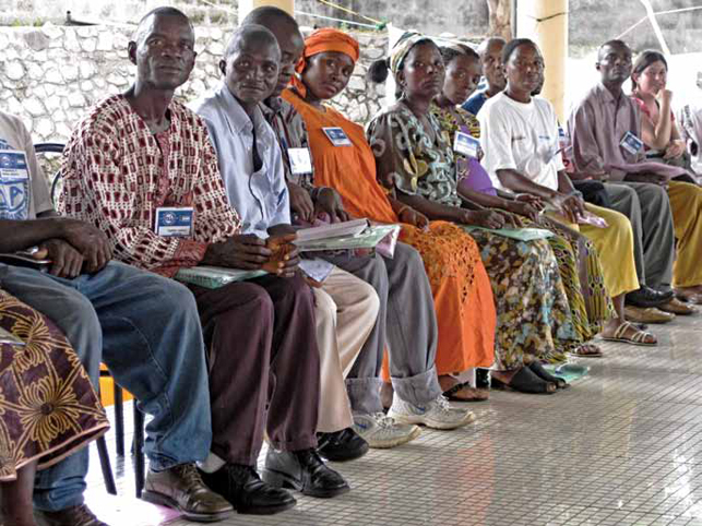 ugandan teachers sitting in line