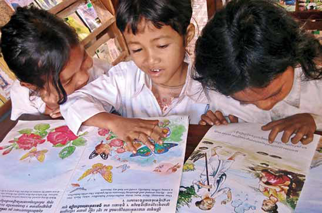 young students looking at papers on table