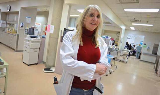 female nurse or doctor standing in hospital