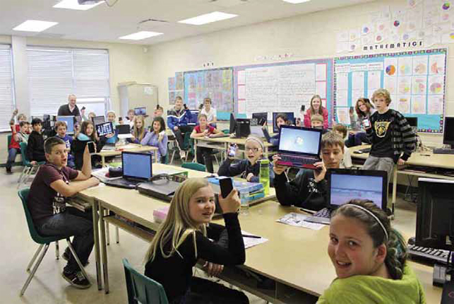 photo of students in classroom working on computers