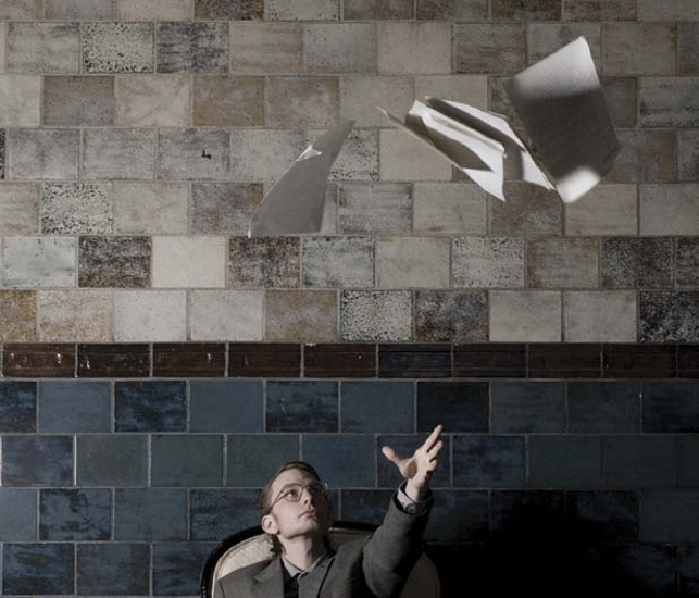 Stock photo of man throwing papers into the air