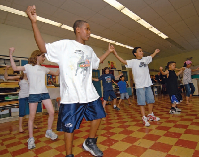 children dancing or exercising in classroom
