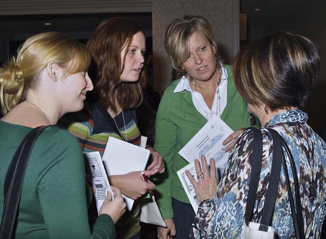 female etfo members standing together having a discussion