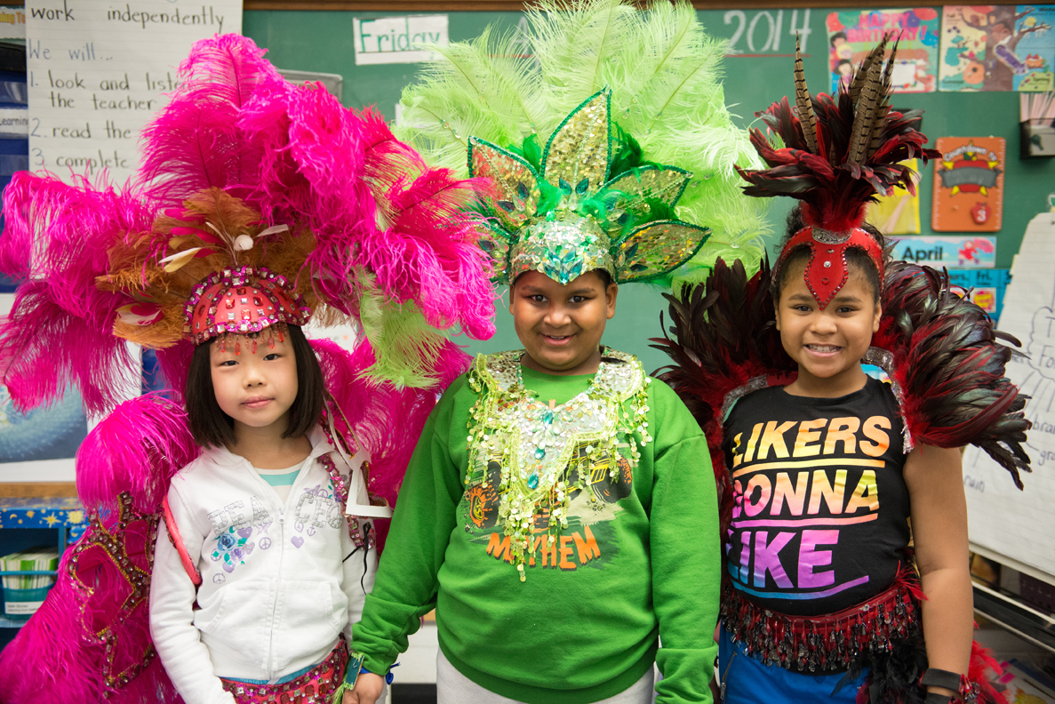 Young elementary students wearing Caribana style headwear