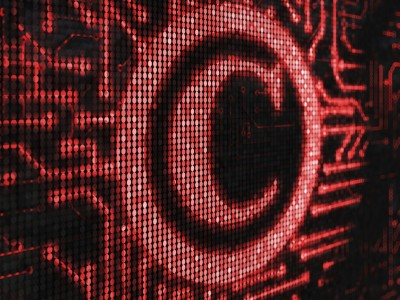Graphic of copyright symbol with circuitry coming out of it